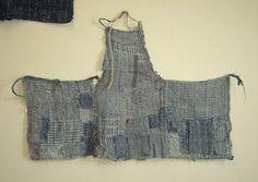 Patched boro apron from fragments of indigo dyed hemp cloth, mostly koshi/checked: Sri threads