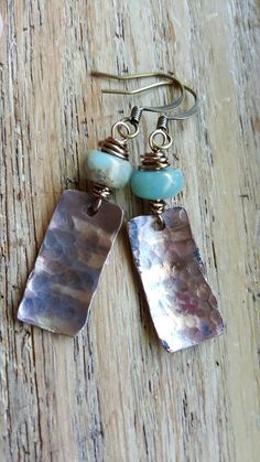 Check out this item in my Etsy shop https://www.etsy.com/listing/294364247/flame-torched-copper-earrings-ocean