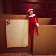 """Our Elf on the Shelf arrived with a note from Santa and an empty box for each child. They were instructed to fill their box with toys to donate to other children, so Santa would have room to leave new toys. Great Idea!!"""