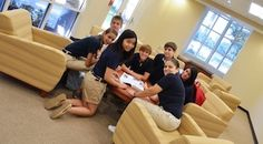 """Oxbridge Academy students in the """"cafe"""" side of the iCommons library"""