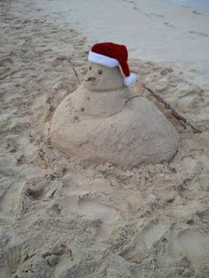 in Florida...now that's my kind of snowman......I mean sandman!