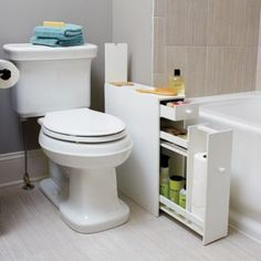 Bathroom Floor Cabinet So expensive, but this is exactly my bathroom setup and would be awesome