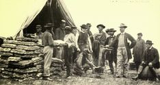 Union soldiers and civilians weighing bread in an unidentified camp during the Civil War. From Miller's Photographic History of the Civil War.