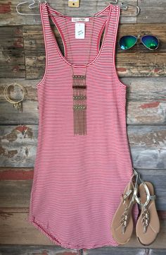The Let's Have Some Fun Striped Tank Dress in Red is stretchy, striped, and oh so fabulous! A great basic that can be dressed up or down! Sizing: Small: 0-3 Medium: 5-7 Large: 9-11 True to Size with a