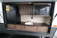 2016 New Forest River Puma 25TFS Travel Trailer in Indiana IN.Recreational Vehicle, rv, 2016 Forest River Puma25TFS, 30 Gal Fuel Pump, 30lb. Gas Bottles & Cover, Advantage Package, Aluminum Rims, Bath Skylight, CO Detector, Colored Front Fiberglass Cap, Double Elec Queen Bed, Folding Grab Handle, Outside Kitchen, Stabilizer Jacks, Value Shopper Package, Water Heater By-Pass, Zip Screen,