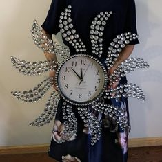 large living room with modern art wall clock, silent Non-ticking,high quality quartz battery operated movement. Perfect for House warming gift,holiday gift etc made from rhinestones decorated makes even shine.