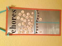 The kids first chores chart. Easy: steel from hardware store, craft tape, wood pieces with magnet tape and alphabet stickers.