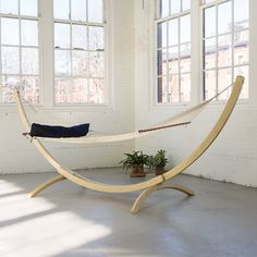 """Hand-crafted from durable netting and responsibly harvested shorea wood, this classic hammock is paired with a crisp, navy cushion for comfortable summer lounging.- Polyester, responsibly harvested shorea wood- Spot clean- 355 lbs. max capacity- Stand/hanging hardware not included- Bar: 4'7""""L- ImportedBed: 4'7""""W, 6'1""""LTotal Length: 12'2"""""""