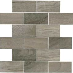 Emblem Gray 2x4 Brick-joint mosaic ceramic wood look tile.  Classic wood grain visuals and a smooth surface.  Mounted on a 12x12 sheet.