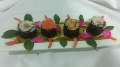 From right to left: Octopus sushi with ginger, shrimp sushi with curry rice, salmon sushi with wild rice and tuna sushi with red pepper