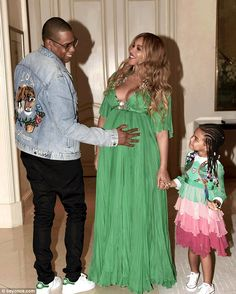 Family time: Jay Z placed his hand on his wife's belly while daughter Blue Ivy looked at m...