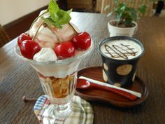 A Parfait with Fresh Cherries produced in Yamagata and Cafe mocha.  さくらんぼ屋さんのパフェ。カフェモカと。  http://takahashi-fl.com/cafe.html