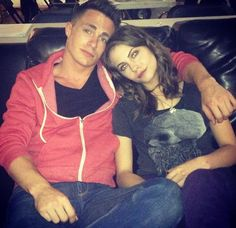 Colton Haynes (Roy Harper) and Willa Holland (Thea Queen) on the set of Arrow.
