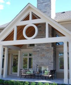 stone fireplace centered in the back of house