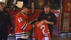 Patrick Kane presents Kevin with a #Blackhawks jersey. #WhatsYourGoal
