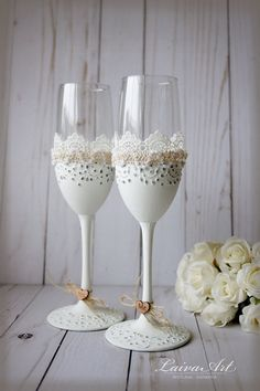 Wedding Champagne Flutes Toasting Glasses Rustic Toasting Flutes Wedding Champagne Flutes Bride and Groom Wedding Glasses These glasses are perfect for the bride and groom on their toast . The glasses are wrapped with burlap and then overlay in lace, flowers and decorated with hearts with your names and date. You can have these glasses personalized with names or dates for free.  If you are looking for matching accessories please visit our sections: Matching Cake server set & Knife…