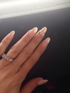 Nude almond nails.