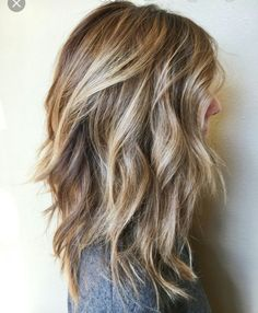 Long layered hair cut. Wavy