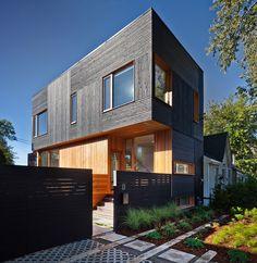 architecture dark modern home in toronto illuminated from the inside chad garden pod