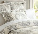 Madie - you could put a lavender comforter with this or just a few lavender and purple pillows as accents.   Lucianna Medallion Duvet Cover, Twin, Gray- M