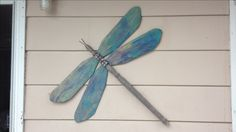 Dragonfly from ceiling fan blades and weathered bed post with a bit of bling added.