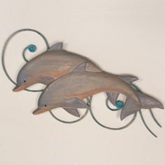 Love these for over the fireplace.  Bottlenose Dolphins Indoor Outdoor Wall Sculpture