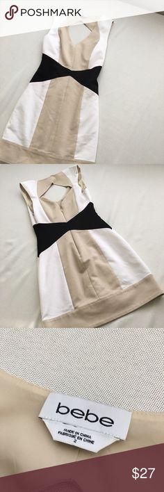 Mini BEBE dress cream, white, and black. Great used condition, no visible flaws, super classy dress bebe Dresses Mini
