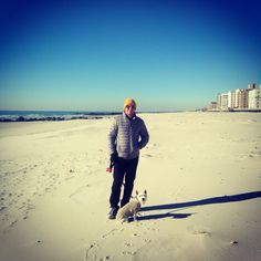 My hubby and our Westie buttercup #winter #beach #chilly #sand #westie