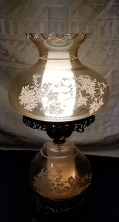Vintage GWTW Gone with the Wind Electric Table Hurricane Lamp Light Amber Glass White Frost Flowers and Chimney Accurate Casting Co Hurricane Lamps, Vintage Hurricane Lamps, Glass Hurricane Lamps, Lamp, Glass, Vintage Lamps, Amber Glass, Glass Lamp, Vintage