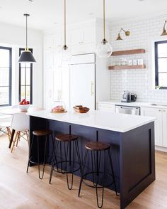 Kitchen island ideas for inspiration on creating your own dream kitchen. diy painted small kitchen design - with seating and lighting island Kitchen Island Ideas with Seating & Storage Home Decor Kitchen, Rustic Kitchen, Diy Kitchen, Home Kitchens, Kitchen Ideas, Kitchen Cabinets, Awesome Kitchen, Black Kitchen Decor, Space Kitchen