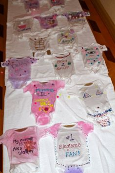 Great idea for a baby shower party! Decorate onsies!