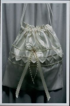 Off-white satin with heart lace trim.
