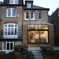 Extension en bardage bois et baie vitrée                                                                                                                                                                                 Plus