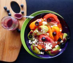 Simple Mediterranean Tomato Salad with Blueberry Vinaigrette!    http://healingtomato.com/blog/2014/07/11/mediterranean-tomato-salad/
