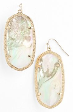 gold and shell statement earrings