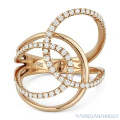 The featured ring is cast in 14k rose gold and showcases a fancy design made up of overlapping loops and pave-set round brilliant cut diamonds.  #diamonds #14kjewelry #14kgold #rosegold #rings