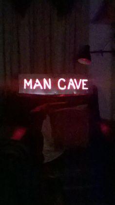 CAVE Man sign
