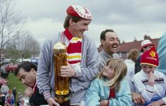 Player-Manager Kenny Dalglish and goalkeeper Bruce Grobbelaar celebrate clinching the league and cup double on the open-top bus homecoming t...