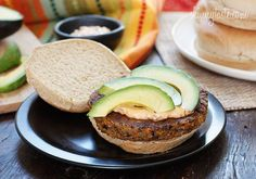 Spicy Black Bean Burgers with Chipotle Mayonnaise - One bite of this spicy black bean burger with spicy chipotle mayo and creamy avocado and you won't miss the meat!