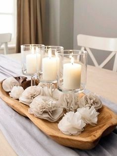 Love the white candles and flowers, offset just a bit by the natural wood tray they're set in.
