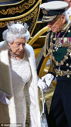 Taking the strain: A steadying hand from Prince Philip for the Queen at the State Opening of Parliament this week