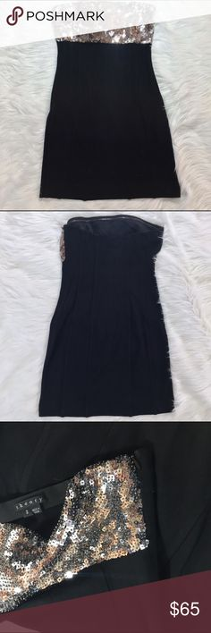 """Theory NYE Sparkely Strapless Dress 2 Perfect for NYE 🎉🍾 Theory Black Lensleyan Silk Combo Silver Sequin Bodice Cocktail Dress size 2. This black lensleyan cocktail dress features a silver sequin bodice, strapless, straight neckline, silky sheath body, enclosed side zip closure. Measurements from Brand- Bust: 32""""-33""""; Waist: 24-25""""; Hips: 36"""" Length- 25"""" made out of 94% viscose, 6% Spandex. Combo is 100% Silk. Lining is 91% Silk and 9% Spandex. In good condition Theory Dresses Mini"""