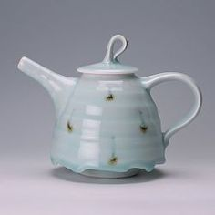 A porcelain teapot by Matthew Blakely. The glaze emphasises the ridges on the spout and body and the drips at the base of the teapot are perfect.