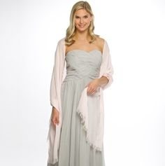 The perfect dressy accessory to keep your bridal party covered, warm and coordinated! Bridesmaid shawl is silky and lightweight. Free monogramming with the recipients' initial and available in gray, ivory or light pink.