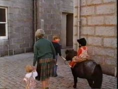 Youtube:  Queen Elizabeth with grandchildren at Balmoral circa 1991-Zara Phillips and Prince Harry ride their horses; Prince William leads Princess Beatrice on a pony and the Queen holds Princess Eugenie's hand.