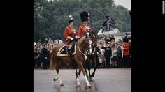 Beautifully regal  June 12, 1965: Queen Elizabeth II and Prince Philip return to Buckingham Palace after the Trooping The Colour ceremony.