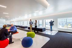 We love the modern yet fun aesthetic of this lounge, don't you? Photo Credit: Brandon Stengel of Farm Kid Studios #interiordesign #officedesign