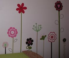 painted flowers on the wall are sweet