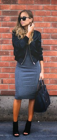 Street fashion grey dress and bombed jacket.