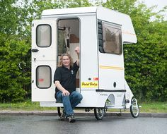 It's the cramper van! Dubbed the Cramper Van, the world's smallest, lightest RV can seat up to four close friends in a pinch although one of the seats folds down over the two-ring hob and sink.